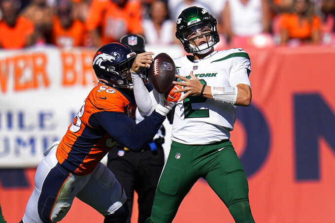 New York Jets quarterback Zach Wilson (2) is sacked by Denver Broncos outside linebacker Von Miller (58) during the first half of an NFL football game, Sunday, Sept. 26, 2021, in Denver. (AP Photo/Jack Dempsey)