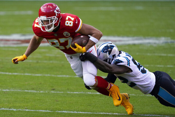 Kansas City Chiefs tight end Travis Kelce (87) is tackled by Carolina Panthers middle linebacker Tahir Whitehead (52) an NFL football game in Kansas City, Mo., Sunday, Nov. 8, 2020. (AP Photo/Jeff Roberson)
