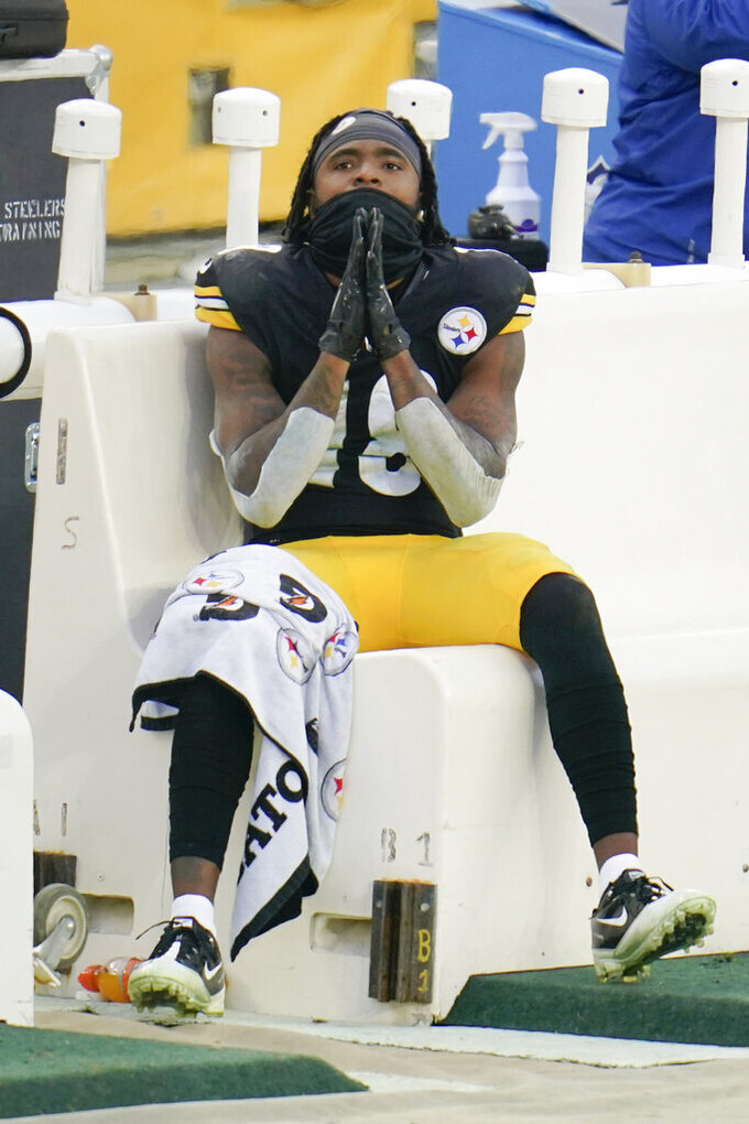 Pittsburgh Steelers wide receiver Diontae Johnson (18) sits on the bench as his team is up by four points while the Indianapolis Colts have the ball with time running down during the second half of an NFL football game, Sunday, Dec. 27, 2020, in Pittsburgh. (AP Photo/Gene J. Puskar)