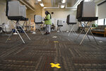 A voter casts a ballot at the North End Senior Center on Primary Day, Tuesday, Aug. 11, 2020, in Hartford, Conn. (AP Photo/Jessica Hill)