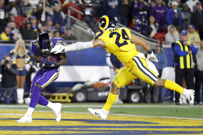Baltimore Ravens wide receiver Marquise Brown scores past Los Angeles Rams safety Taylor Rapp during the first half of an NFL football game Monday, Nov. 25, 2019, in Los Angeles. (AP Photo/Marcio Jose Sanchez)