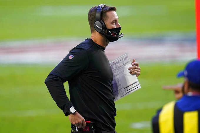 Arizona Cardinals head coach Kliff Kingsbury watches during the first half of an NFL football game against the Los Angeles Rams, Sunday, Dec. 6, 2020, in Glendale, Ariz. (AP Photo/Ross D. Franklin)