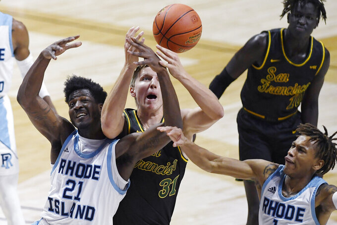 Rhode Island's Makhi Mitchell, left, San Francisco's Jonas Visser, center, and Rhode Island's Fatts Russell, right, vie for a rebound in the first half of an NCAA college basketball game, Sunday, Nov. 29, 2020, in Uncasville, Conn. (AP Photo/Jessica Hill)