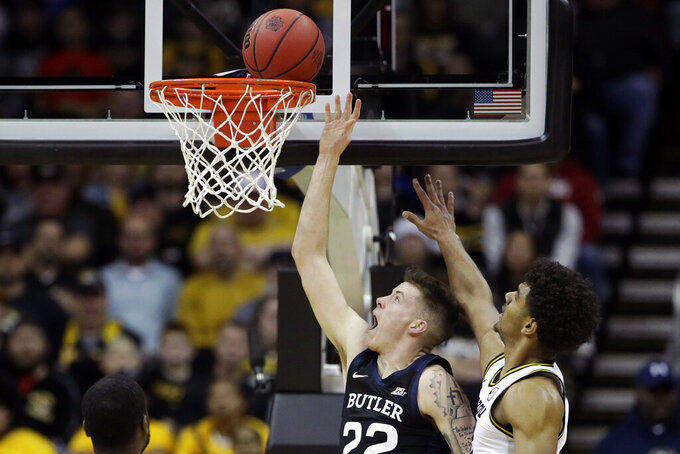 Butler forward Sean McDermott (22) gets past Missouri guard Mark Smith, right, to shoot during the first half of an NCAA college basketball game Monday, Nov. 25, 2019, in Kansas City, Mo. (AP Photo/Charlie Riedel)