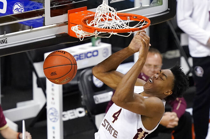 Florida State guard Scottie Barnes (4) slams home a dunk during the second half of an NCAA college basketball game against North Carolina in the semifinal round of the Atlantic Coast Conference tournament in Greensboro, N.C., Friday, March 12, 2021. (AP Photo/Gerry Broome)