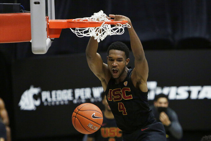 FILE - In this Feb. 13, 2021, file photo, Southern California's Evan Mobley dunks during the second half of the team's NCAA college basketball game against Washington State in Pullman, Wash. Mobley was selected by the Cleveland Cavaliers in the NBA draft Thursday, July 29. (AP Photo/Young Kwak, File)