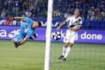 FILE - In this July 4, 2019, file photo, LA Galaxy forward Zlatan Ibrahimovic, right, scores a goal past Toronto FC goalkeeper Quentin Westberg during the second half of an MLS soccer match in Carson, Calif. (AP Photo/Ringo H.W. Chiu, File)