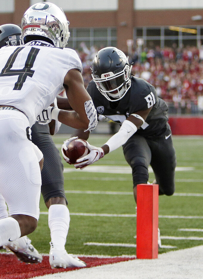 Washington State wide receiver Renard Bell (81) runs for a touchdown against Oregon during the first half of an NCAA college football game in Pullman, Wash., Saturday, Oct. 20, 2018. (AP Photo/Young Kwak)