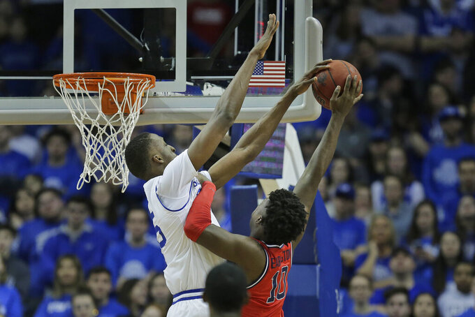 Seton Hall's Romaro Gill, left blocks a shot by St. John's Marcellus Earlington during the second half of an NCAA college basketball game in Newark, N.J., Sunday, Feb. 23, 2020. Seton Hall defeated St. John's 81-65. (AP Photo/Seth Wenig)