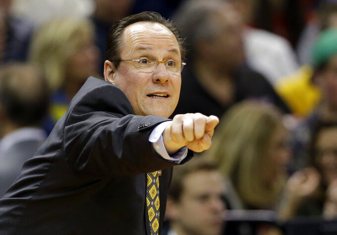 FILE - In this March 17, 2017, file photo, Wichita State head coach Gregg Marshall directs his team against Dayton during the first half of a first-round game in the men's NCAA college basketball tournament in Indianapolis. Under the radar and out of the spotlight, Wichita State has quietly put together a team that could upend all those predictions of a three-way fight for the league title. They won nine of their last 11 games last season, won twice more in the AAC tourney and picked up three more wins in the NIT. (AP Photo/Michael Conroy, File)