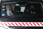 Chief EU negotiator Michel Barnier sits in a car as he leaves the chancellery following a meeting with German Chancellor Angela Merkel in Berlin, Germany, Monday, Oct. 5, 2020. (AP Photo/Markus Schreiber)
