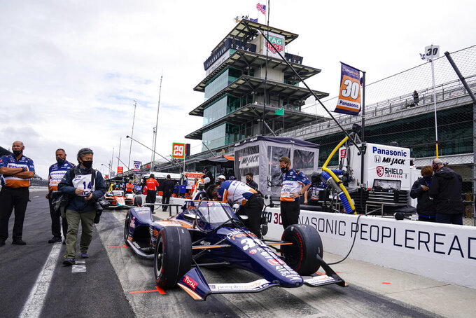 Takuma Sato, of Japan, sits in his car before the start of the final practice for the Indianapolis 500 auto race at Indianapolis Motor Speedway in Indianapolis, Friday, May 28, 2021. (AP Photo/Michael Conroy)