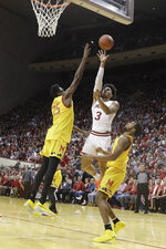 Indiana's Justin Smith (3) shoots over Maryland's Jalen Smith (25) during the first half of an NCAA college basketball game, Sunday, Jan. 26, 2020, in Bloomington, Ind. (AP Photo/Darron Cummings)