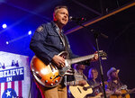 """FILE - This March 9, 2020 file photo shows Jason Isbell, from left, Todd Snider, T.J. Osborne and Aaron Lee Tasjan performing at the To Nashville, With Love Benefit Concert in Nashville, Tenn. Isbell is king of the Americana genre, but he's ambitious for more. The new """"Reunions"""" album reaches out sonically to people who might not normally listen to that type of music, but Isbell's well-crafted songs lie at the center of what he does. (Photo by Amy Harris/Invision/AP, File)"""