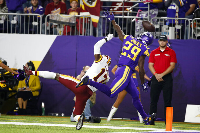 FILE - In this Oct. 24, 2019, file photo, Minnesota Vikings cornerback Xavier Rhodes (29) breaks up a pass intended for Washington Redskins wide receiver Terry McLaurin (17) during the first half of an NFL football game in Minneapolis. Halfway through the pioneer season of putting pass interference up for replay review, there is little evidence that the new wrinkle has indeed made the action on the field more consistently officiated, with coaches, players and fans either bemused, confused or disturbed. (AP Photo/Bruce Kluckhohn, File)