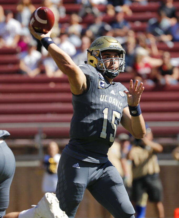 UC Davis quarterback Jake Maier (15) passes against Stanford in the first half in an NCAA college football game in Stanford, Calif., Saturday, Sept. 15, 2018. (AP Photo/Jim Gensheimer)