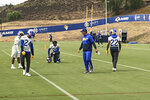 Los Angeles Rams defensive coordinator Brandon Staley, second from right, instructs safety Taylor Rapp (24), cornerback Jalen Ramsey (kneeling) and cornerback Troy Hill (22) during football practice at the team's training complex in Thousand Oaks, California, Friday, Sept. 11, 2020. Staley is in his first season as an NFL coordinator after a meteoric rise in his profession since 2016, when he was the defensive coordinator at Division III John Carroll University. (AP Photo/Greg Beacham)