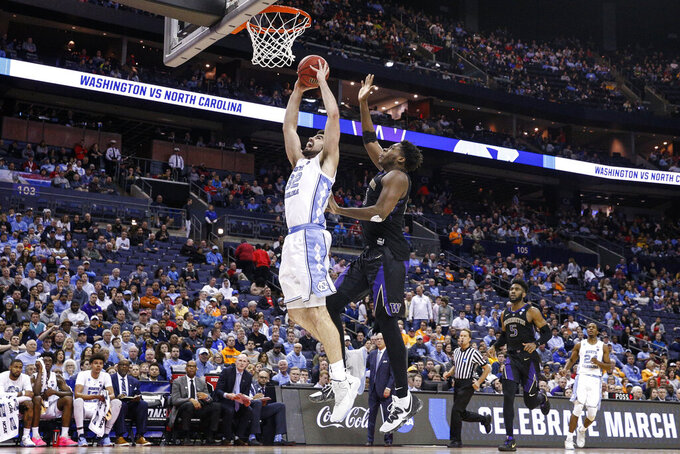 North Carolina's Luke Maye (32) shoots against Washington's Noah Dickerson, right, in the second half during a second-round men's college basketball game in the NCAA Tournament, Sunday, March 24, 2019, in Columbus, Ohio. (AP Photo/John Minchillo)