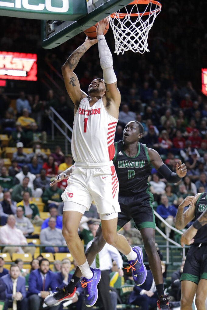 Dayton's Obi Toppin (1) shoots the ball as George Mason's Goanar Mar, right, defends during the first half of an NCAA college basketball game Tuesday, Feb. 25, 2020, in Fairfax, Va.(AP Photo/Luis M. Alvarez)