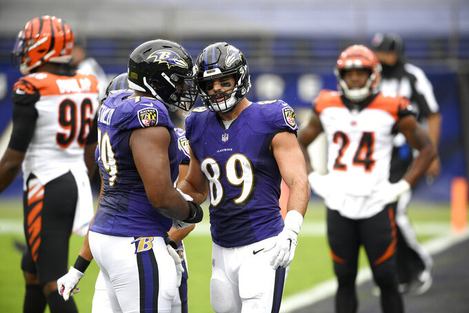 Baltimore Ravens tight end Mark Andrews (89) is congratulated by offensive tackle Ronnie Stanley (79) after catching a touchdown pass from quarterback Lamar Jackson, not visible, during the first half of an NFL football game against the Cincinnati Bengals, Sunday, Oct. 11, 2020, in Baltimore. (AP Photo/Nick Wass)