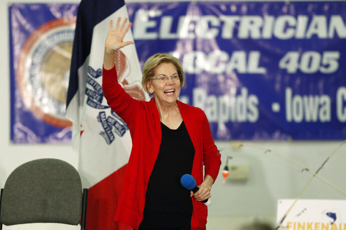 Democratic presidential candidate Sen. Elizabeth Warren arrives to speak at a fund-raising fish fry for U.S. Rep. Abby Finkenauer, D-Iowa, Saturday, Nov. 2, 2019, at Hawkeye Downs Expo Center in Cedar Rapids, Iowa. (AP Photo/Charlie Neibergall)