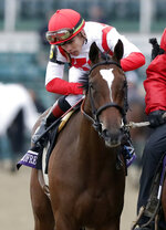 Irad Ortiz, Jr. celebrates after riding Newspaperofrecord to victory in the Breeders' Cup Juvenile Fillies Turf horse race at Churchill Downs, Friday, Nov. 2, 2018, in Louisville, Ky. (AP Photo/Darron Cummings)