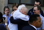 Democratic presidential candidate Bernie Sanders, I-Vt., hugs Maria Garcia Bulkloy, who is undergoing cancer treatment, after participating in a rally alongside unions, hospital workers and community members against the closure of Hahnemann University Hospital in Philadelphia, Monday, July 15, 2019. (AP Photo/Jacqueline Larma)