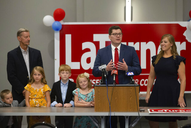 Surrounded by family, Jake LaTurner talks to reporters after winning the Republican primary for Kansas' 2nd Congressional District, Tuesday, Aug. 4, 2020, in Topeka, Kan. (Evert Nelson/The Topeka Capital-Journal via AP)