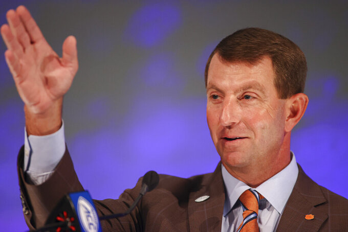 Clemson head coach Dabo Swinney answers a question during an NCAA college football news conference at the Atlantic Coast Conference media days in Charlotte, N.C., Thursday, July 22, 2021. (AP Photo/Nell Redmond)