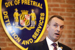Maryland Assistant State Attorney Patrick Seidel speaks during a news conference announcing the indictment of correctional officers, Tuesday, Dec. 3, 2019, in Baltimore. Twenty five correction officers, most of whom were taken into custody earlier in the day, are charged with using excessive force on detainees at state-operated Baltimore pretrial correctional facilities. (AP Photo/Julio Cortez)