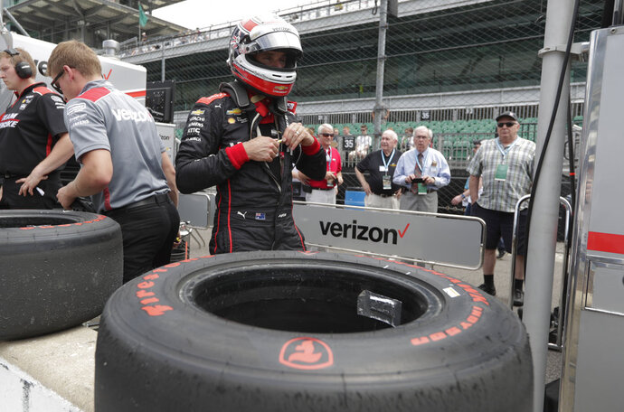 Will Power, of Australia, removes his helmet after practicing for the IndyCar Indianapolis 500 auto race at Indianapolis Motor Speedway, in Indianapolis Tuesday, May 15, 2018. (AP Photo/Michael Conroy)