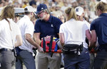 Medical personnel carry Rice quarterback Wiley Green from the field with his head stabilized after he was injured on a tackle on a keeper play just short of the goal line during the first half of an NCAA college football game against Wake Forest, Friday, Sept. 6, 2019, in Houston. (AP Photo/Michael Wyke)