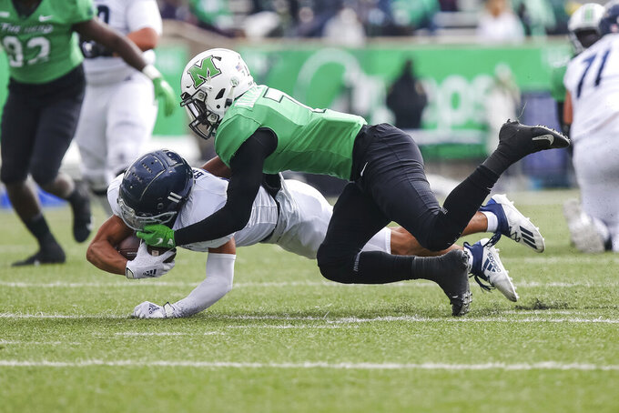 Marshall's Jaylon McClain-Sapp (7) tackles Rice wide receiver Jake Bailey (11) after a catch during an NCAA college football game on Saturday, Dec. 5, 2020, in Huntington, W.Va.  (Sholten Singer/The Herald-Dispatch via AP)