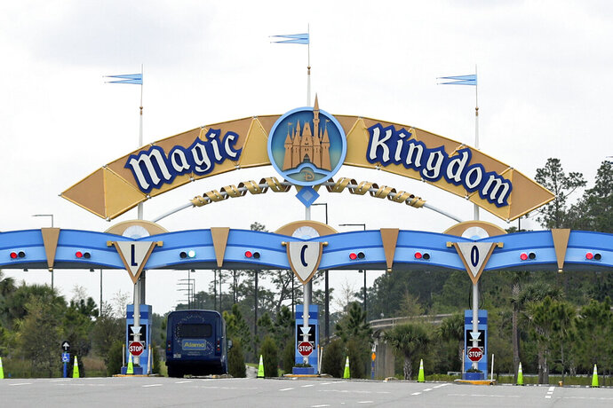 FILE - In this March 16, 2020, file photo, the entrance to the parking lot at the Magic Kingdom at Walt Disney World is closed in Lake Buena Vista, Fla. The Splash Mountain ride at Disney parks in California and Florida is being recast. Disney officials said the ride would no longer be tied to the 1946 movie,