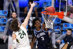 Villanova forward Brandon Slater (3) dunks on Baylor guard Matthew Mayer (24) in the second half of a Sweet 16 game in the NCAA men's college basketball tournament at Hinkle Fieldhouse in Indianapolis, Saturday, March 27, 2021. (AP Photo/Michael Conroy)