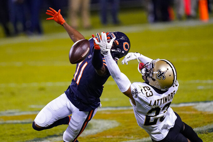 New Orleans Saints cornerback Marshon Lattimore (23) breaks up a pass intended for Chicago Bears wide receiver Darnell Mooney (11) in the second half of an NFL football game in Chicago, Sunday, Nov. 1, 2020. (AP Photo/Charles Rex Arbogast)