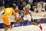 Mississippi guard Luis Rodriguez (15) dribbles down court past Tennessee guard Keon Johnson (45) during the first half of an NCAA college basketball game in Oxford, Miss., Tuesday, Feb. 2, 2021. (AP Photo/Rogelio V. Solis)