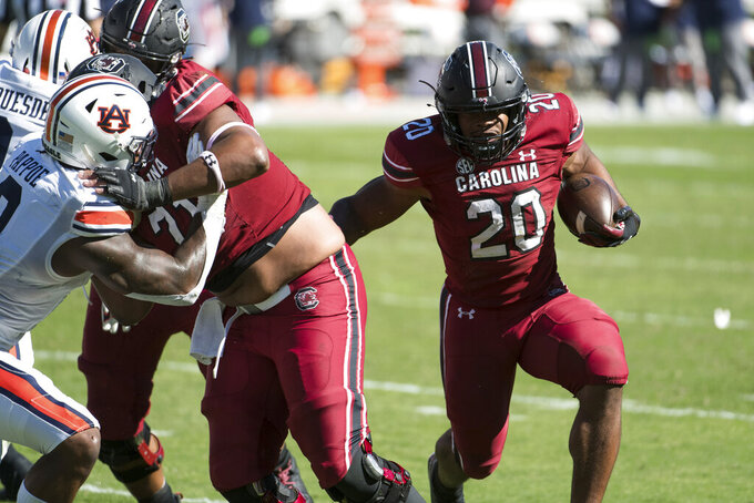 South Carolina running back Kevin Harris (20) runs with the ball for a touchdown during the second half of an NCAA college football game Saturday, Oct. 17, 2020, in Columbia, S.C. South Carolina defeated Auburn 30-22. South Carolina defeated Auburn 30-22. (AP Photo/Sean Rayford)