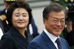 South Korean President Moon Jae-in and his wife Kim Jung-sook, left, attend a wreath laying ceremony at the Tomb of the Unknown Soldier near the Kremlin in Moscow, Russia, Thursday, June 21, 2018. (Sergei Karpukhin/Pool Photo via AP)