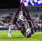 Mississippi State tight end Farrod Green (82) plants a flag at Vaught-Hemingway Stadium following a win over Mississippi in Oxford, Miss., Thursday, Nov. 22, 2018. (Bruce Newman, Oxford Eagle via AP)