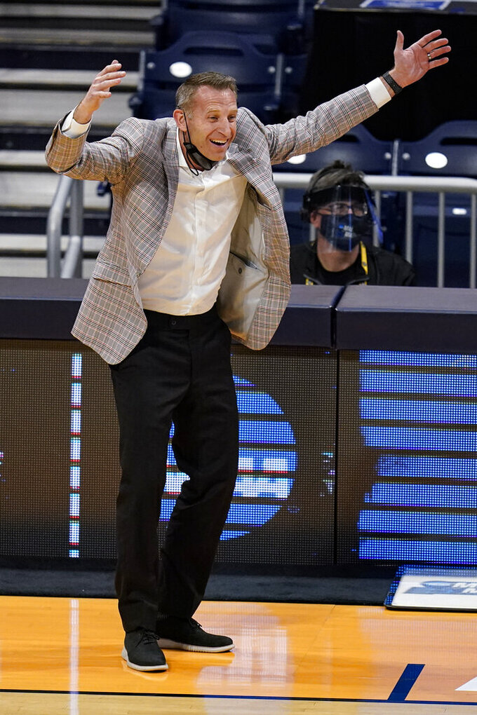 Alabama head coach Nate Oats reacts to a call in the second half of a first-round game against Iona in the NCAA men's college basketball tournament at Hinkle Fieldhouse in Indianapolis, Saturday, March 20, 2021. (AP Photo/Michael Conroy)