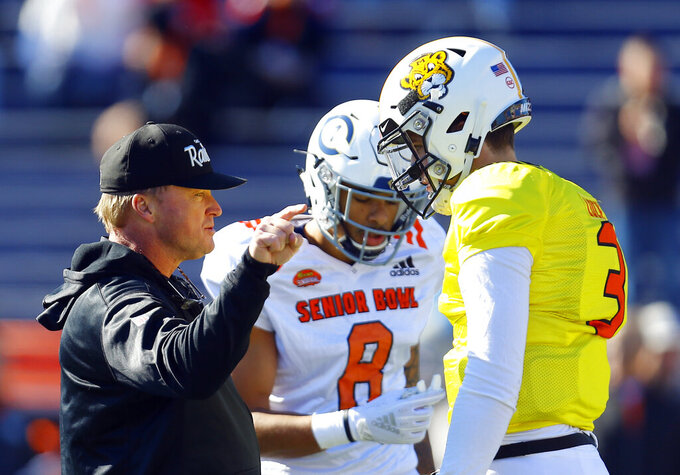North head coach Jon Gruden of the Oakland Raiders talks with North quarterback Drew Lock of Missouri (3) during practice for Saturday's Senior Bowl NCAA college football game, Thursday, Jan. 24, 2019, in Mobile, Ala. (AP Photo/Butch Dill)