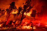 FILE - In this Nov. 1, 2019 file photo flames from a backfire consume a hillside as firefighters battle the Maria Fire in Santa Paula, Calif. According to the Ventura County Fire Department, the blaze has scorched more than 8,000 acres and destroyed at least two structures. (AP Photo/Noah Berger,File)