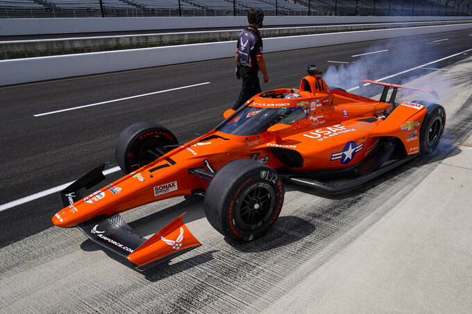 Conor Daly pulls of of the pit area during practice for the Indianapolis 500 auto race at Indianapolis Motor Speedway in Indianapolis, Friday, Aug. 14, 2020. (AP Photo/Michael Conroy)