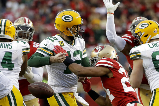 San Francisco 49ers defensive back K'Waun Williams, right, knocks the ball away from Green Bay Packers quarterback Aaron Rodgers during the first half of the NFL NFC Championship football game Sunday, Jan. 19, 2020, in Santa Clara, Calif. The Packers recovered. (AP Photo/Marcio Jose Sanchez)
