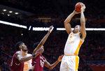 Tennessee forward Grant Williams (2) shoots over South Carolina guard A.J. Lawson (00) and forward Chris Silva (30) during the second half of an NCAA college basketball game Wednesday, Feb. 13, 2019, in Knoxville, Tenn. Tennessee won 85-73. (AP photo/Wade Payne)