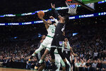Boston Celtics' Jayson Tatum goes to the basket against Sacramento Kings' Richaun Holmes during the first quarter of an NBA basketball game Monday, Nov. 25, 2019, in Boston. (AP Photo/Winslow Townson)