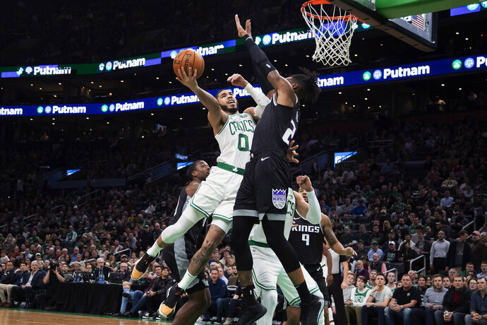 Boston Celtics' Jayson Tatum goes to the basket against Sacramento Kings' Richaun Holmes during the first quarter of an NBA basketball game Monday, Nov. 25, 2019, in Boston. (AP Photo/Winslow Townson)