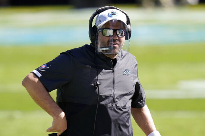 Carolina Panthers head coach Matt Rhule directs his team during the first half of an NFL football game against the Chicago Bears in Charlotte, N.C., Sunday, Oct. 18, 2020. (AP Photo/Brian Blanco)