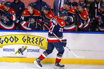Florida Panthers center Alex Wennberg (21) celebrates with teammates after scoring a goal against the Tampa Bay Lightning during the first period of an NHL hockey game on Saturday, May 8, 2021, in Sunrise, Fla. (AP Photo/Mary Holt)